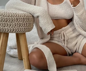 loungewear, beige shorts, and beige cardigan image