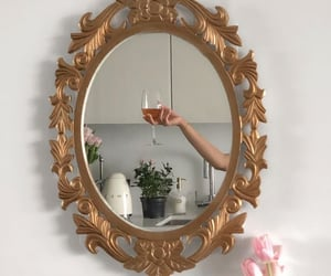 flowers, hand, and mirror image