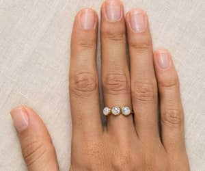 gold, moonstone, and ring image