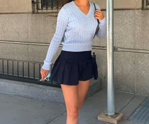 black mini skirt, fashion style mode, and long sleeve shirt image