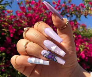 nails, rings, and butterfly image