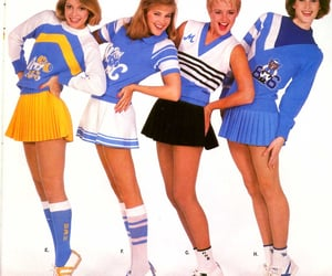 Cheerleaders, saddle shoes, and skirts image