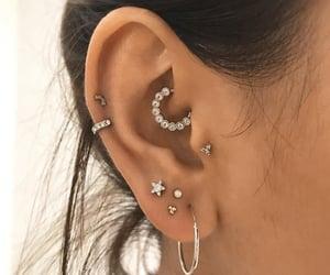 earrings, ear, and piercing image