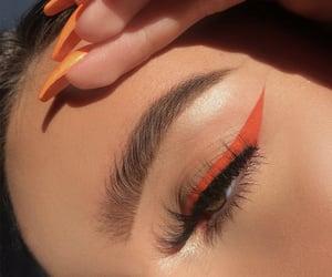 acrylics, eyeliner, and glow image