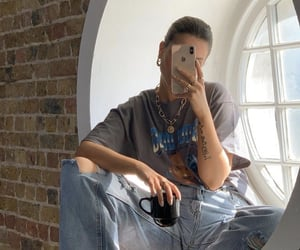 denim jeans, graphic tee shirt, and mirror selfie image