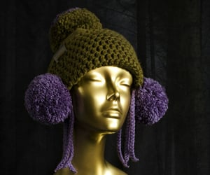 colorful clothes, double pom pom hat, and ear flap hat image