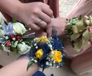 corsage, flowers, and hands image