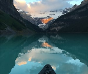 Sunrise canoeing at Lake Louise, Banff National Park, Alberta, Canada