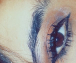 eye, eyeliner, and eye contact image