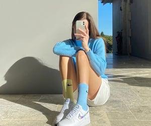 long sleeve top, denim jean shorts, and mirror selfie image