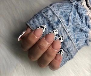 acrylic nails, short nails, and cow print image