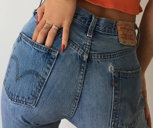 levis jeans, gold ring, and orange top image