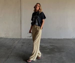 wide leg pants, beige pants, and graphic tee shirt image