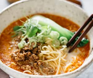 Tantanmen served in a handmade ramen bowl with a pair of chopsticks