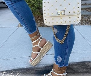 sliders, wedge sandals, and straw bags image