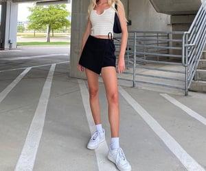 white tank top, black mini skirt, and white nike sneakers image