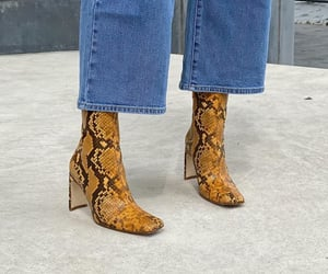 footwear, wide leg jeans, and animal print boots image