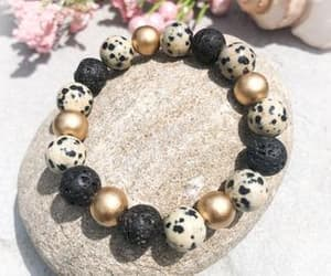 beaded bracelets, black and gold, and essential oil diffuser image