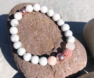 rose gold, pink bracelet, and beaded bracelets image
