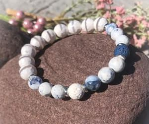 beaded bracelets, white and blue, and essential oil diffuser image
