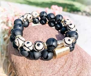 beaded bracelets and black and gold image
