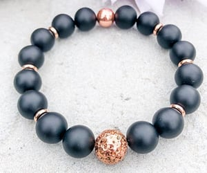 rose gold, beaded bracelets, and essential oil diffuser image