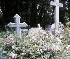 flowers, cross, and cemetery image