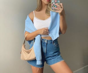 jeans shorts, white crop top, and beige prada bag image