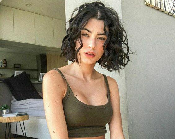 brunette, short hair, and wavy hair image