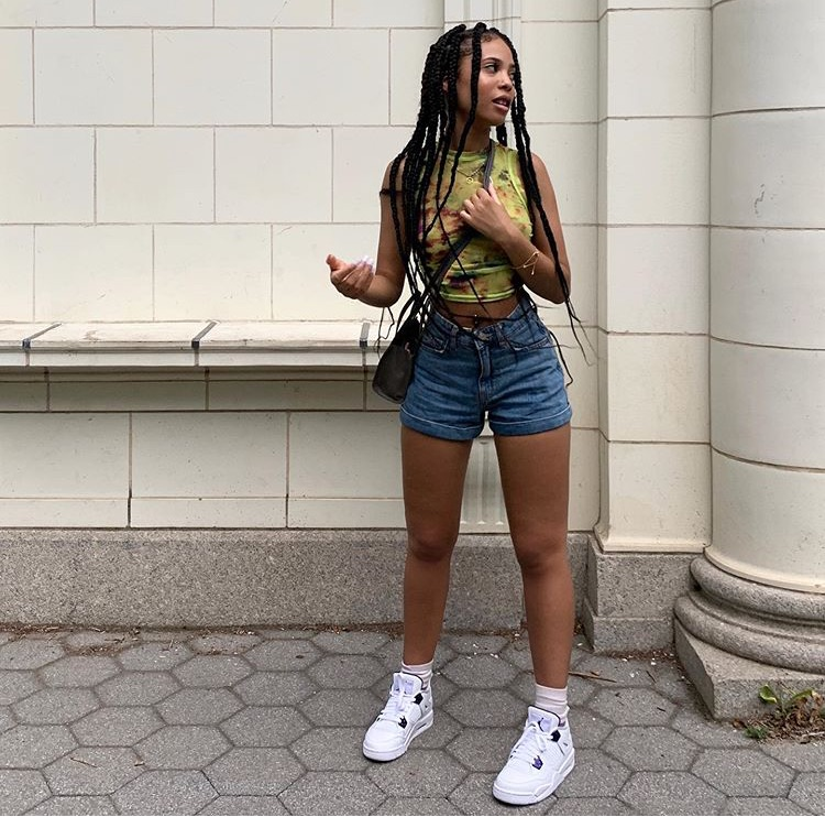 gold jewelry, jean shorts, and green crop top image