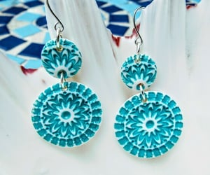 Handmade polymer clay turquoise and white mandala design earrings.