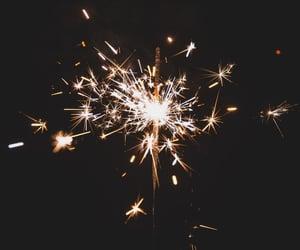 festive, sparkler, and black image