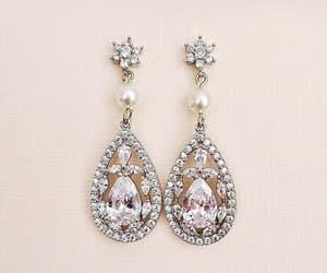 accessories, diamond earrings, and swarovski earrings image