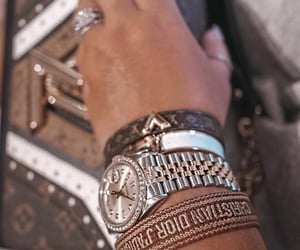 bracelets, tanned girl, and Christian Dior image