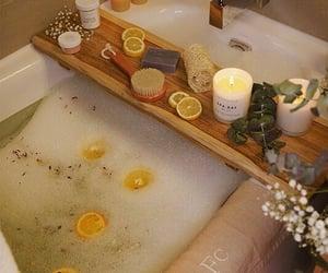 bath tub, candle, and lights image