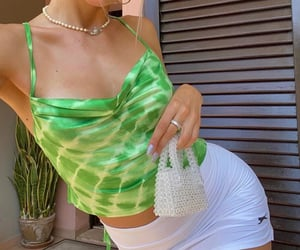 pearl necklace, green crop top, and tie dye top image