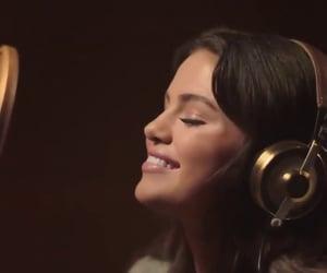 headphones, singing, and selena gomez image