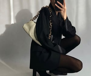 black tights, gold jewelry, and black outfit image