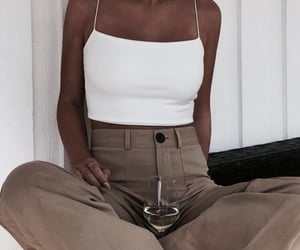 loose pants, suit pants, and white top image