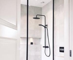 bathroom, showers, and black image