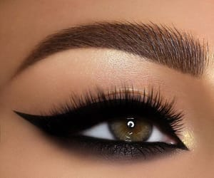 green eyes, black liner, and brown shadow image