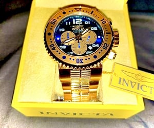 diver, watch, and 18k gold image