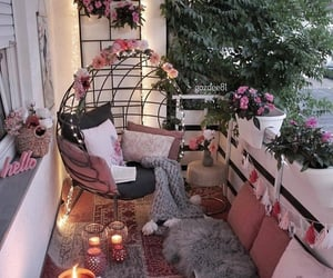 balcony, flowers, and pillows image