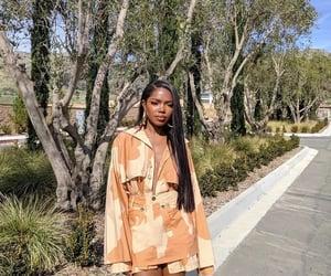 actress, melanin, and orange outfit image