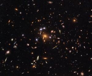 black, orange, and universe image