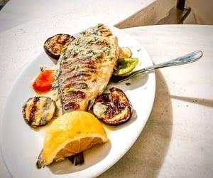 garlic, lemon, and seafood image