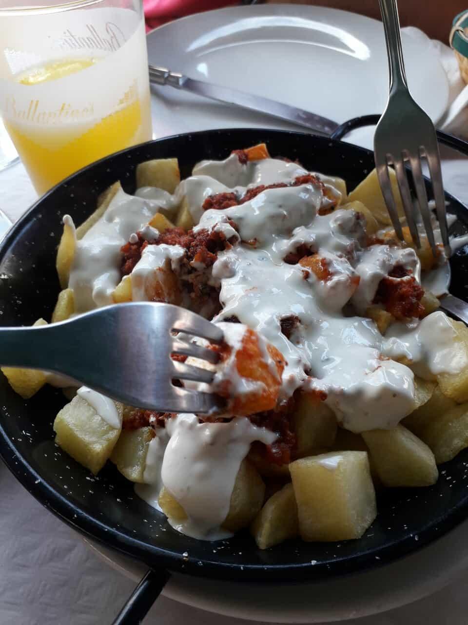 cheese, fries, and chorizo image