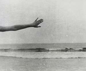 black and white, hand, and sea image