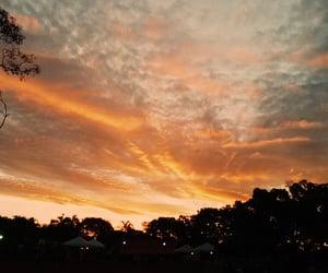 fire, sky, and sun image