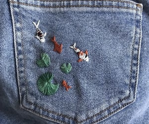 fish, jeans, and embroidery image